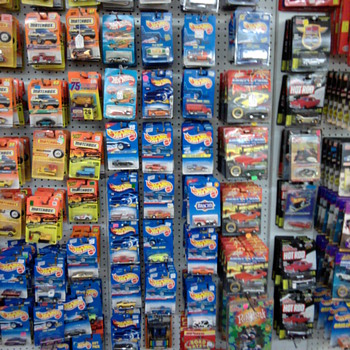 Unopened Hot Wheels and Matchbox cars on the card... - Model Cars
