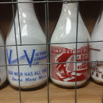 Variety of war slogan milk bottles.....