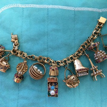 Articulated 14K gold charm bracelet with precious stones - Fine Jewelry