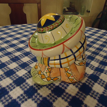 A SMALL MEXICAN COOKIE JAR.