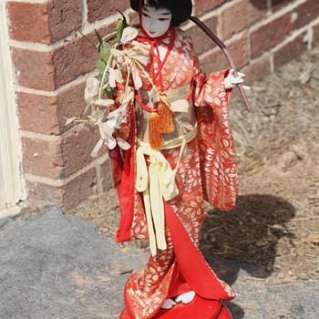 Nishi doll with music box