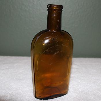 Pre Prohibition Handblowen 1/2 pint Strap Sided Cork Top Bottle