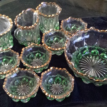 green glassware rimmed in gold, I've had it for about 10 years don't have a clue what it is or the maker  . - Glassware