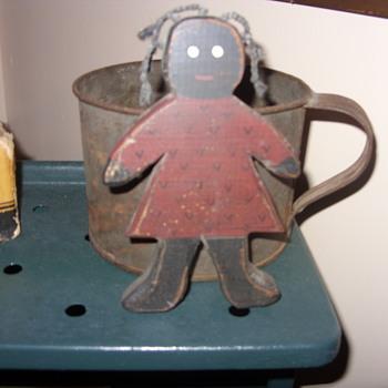 black folk art wood doll