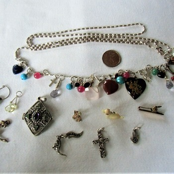 My personal costume charm collection, set on a silver link bracelet and necklace extension. - Costume Jewelry