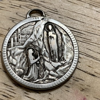Back of my religious metal  - Fine Jewelry