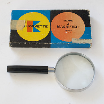 E. J. Korvette Magnifying Glass - Advertising