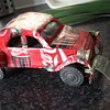 Coca - cola car made out of the cans