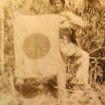 Original WW II Photo of a U.S. Marine Holding a Captured Japanese Flag - Military and Wartime