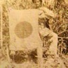 Original WW II Photo of a U.S. Marine Holding a Captured Japanese Flag