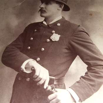 Cabinet card occupational of policeman with billy club and badge