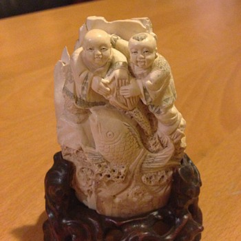 Carved mammoth tusk  (two fisherman) - Asian