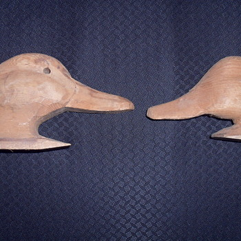 Two wooden duck heads. - Animals