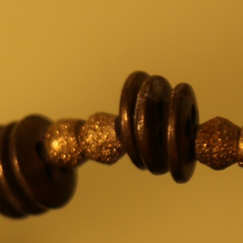 Interesting, heavy, old necklace made with brass buttons
