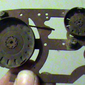 It could be an old Thermostat, Phone parts, a gauge, clock parts or something else