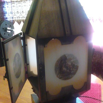 i have two of theses lamps,i know they are over 30 years old are they antique and of any value - Lamps