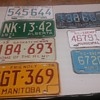Vintage Canadian provincial license plates.