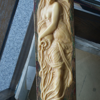 Board with a woman relief