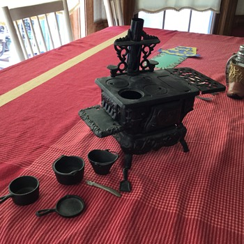 Crescent cast iron toy stove