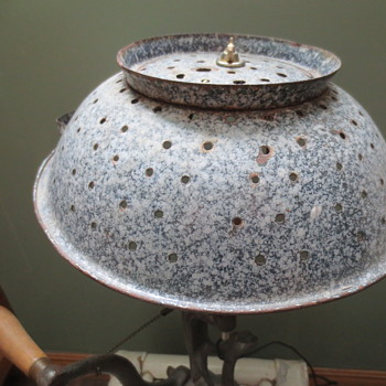Meatgrinder lamp with a graniteware shade..