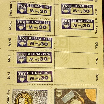 East German DDR Free German Youth membership book with dues stamps.