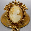 FLORENZA SHELL CAMEO, GOLD TONE BROOCH.