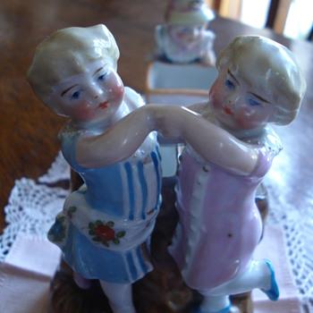 A fairing Conta & Boheme figurine group with match striker