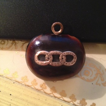 Odd pendant or fob with three interlocking etched circles