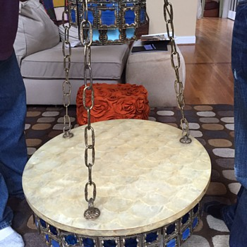 Vintage brass swag lamp with attached capiz table and stain glass hangings