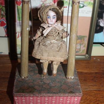 An Antique Squeezebox Mignonette Swinger - Dolls
