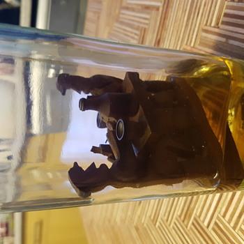 Wooden figures in liqueur bottle