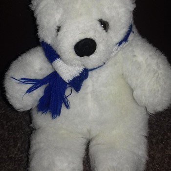 White teddy bear blue and white scarf sitting position