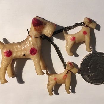 Miniature plastic trio of leashed dogs marked JAPAN - Animals