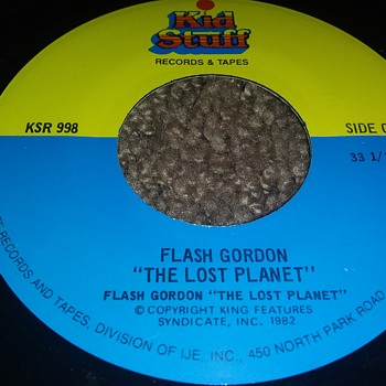 "Flash Gordon...On A 7"" 33 1/3 RPM Vinyl Disc - Records"