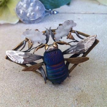 Art nouveau favrile glass and pate de verre insect brooch.