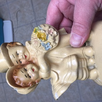 Vintage porcelain dressed up boy and girl statue