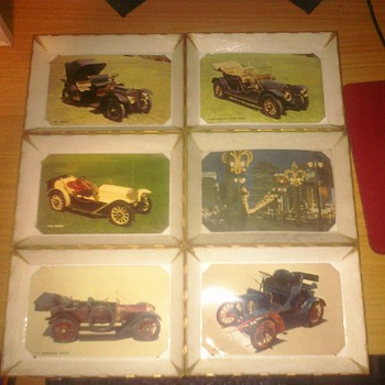 6 Plastic trays with post cards inside.