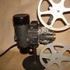 Circa. 1928 Filmo 8mm Projector with storage box.