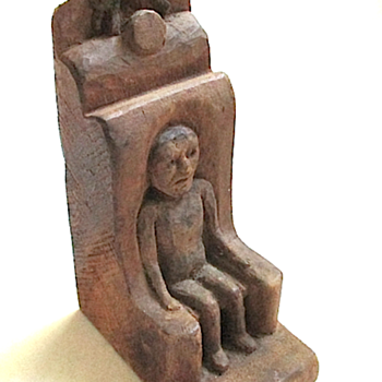 Small woodcarving of a Man in a Chair with a Cat jumping over the Moon - Folk Art