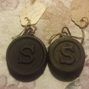 Sterling? Cast iron clock weights  - Clocks