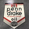Penn drake oil sign and matching oil can