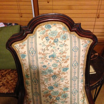 DOES ANYONE KNOW ANYTHING ABOUT THIS ROCKING CHAIR- I BOUGHT IT AT AN ESTSTE SALE