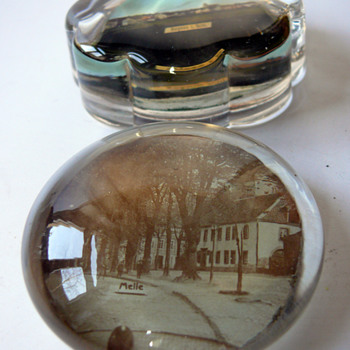 two souvenir paperweights