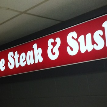 neon 'STEAK AND SUSHI' box sign - Signs