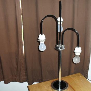 Chrome tri-light lamp.
