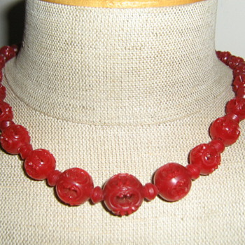 Red carved celluloid necklace  - Costume Jewelry
