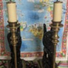 Two brass lamps.