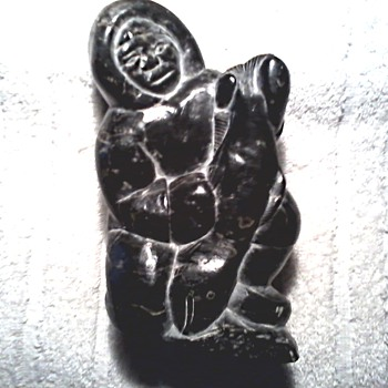 Inuit Stone Carving /A Fisherman with His Catch /Marked with Canadian ID Number and Syllabics for Isa Smiler/ Circa 1948-1970