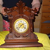 old wooden clock angel blowing bubbles on face