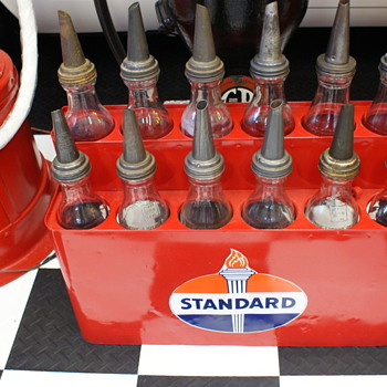 Oil bottles and rack - Petroliana